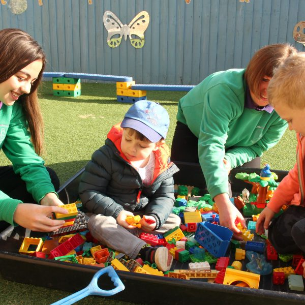 Child playing outside at the Little Explorers Day Nursery